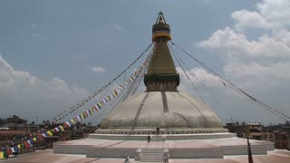 wide shot from the Boudha stupa with a tilt down to the stupa