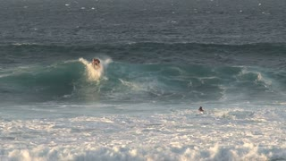 Wind and wave surfing in Maui, Hawaii