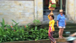 Woman walking in a street of Ubud