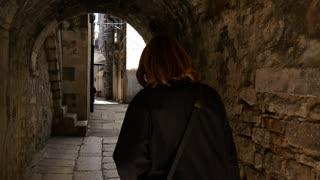 Woman walking in the old town of Split Croatia