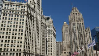 Wrigley Building and bridge withe flags in Chicago