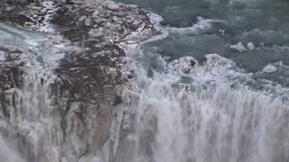 Zoom-out from a waterfall