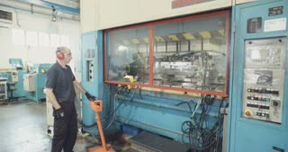 A 250 ton punch press manufacturing metal parts in a factory