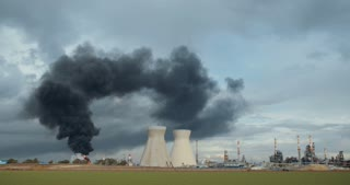 Accident in an oil refinery - explosions and fire with black smoke rising