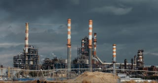Big Oil refinery with smoke stacks and chimneys