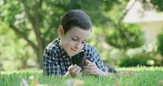 Boy holding a mobile phone