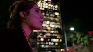 Business woman making phone calls at night