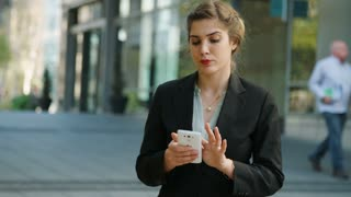 Business woman working with a mobile phone