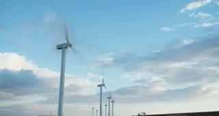 Clean energy - Wind turbines rotating with clouds in the background