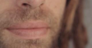Close up shot of a man smoking medicinal marijuana