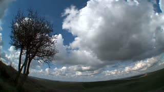 Clouds over countryside time lapse