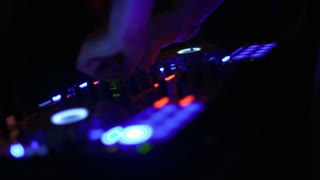 dj playing in a dance party