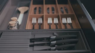 Drawer with silverware in a luxury kitchen