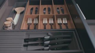 Drawer with silverware in a luxury kitchen