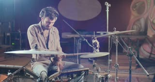 drummer playing electronic drum set in a night club