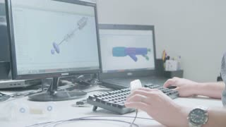 Engineer working on a CAD workstation designing products