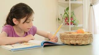 Girl having difficulties preparing homework