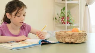 Girl having difficulties preparing homework