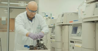 Lab technician working with mass spectrometer in a pharmaceutical laboratory