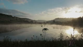Lake at sunrise - with fog over the water