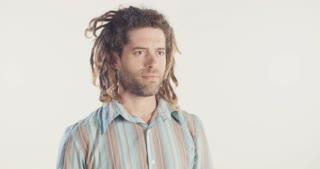 Man smoking medicinal marijuana on a white background