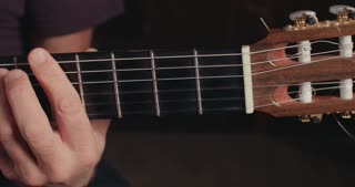 Musician playing an acoustic guitar in a recording studio