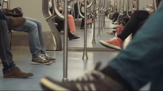People riding metro car