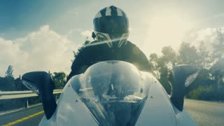 POV shot of a sports motorcycle rider riding at high speed