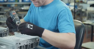 Production worker in a LED lamps assembly line