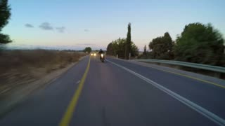 Sport motorcycle driving at high speed on a curved countryside road
