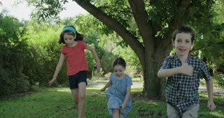 Three kids running together