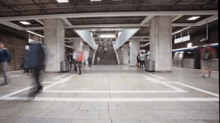 Time Lapse of people boarding trains in a busy metro station