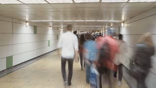 Time Lapse of people in a underground passage in a metro station