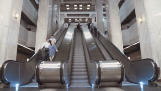 Time Lapse of people riding escalators in a metro station