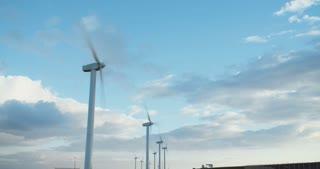 Time lapse shot of wind turbine farm