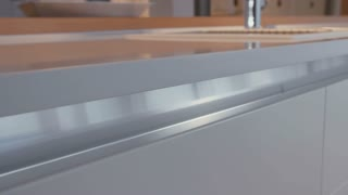 Tracking shot of a cabinet in a luxury kitchen