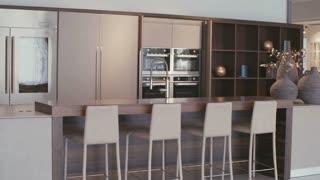 Tracking shot of a large luxury kitchen