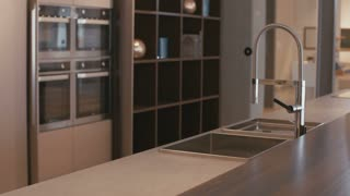 Tracking shot of a large luxury kitchen