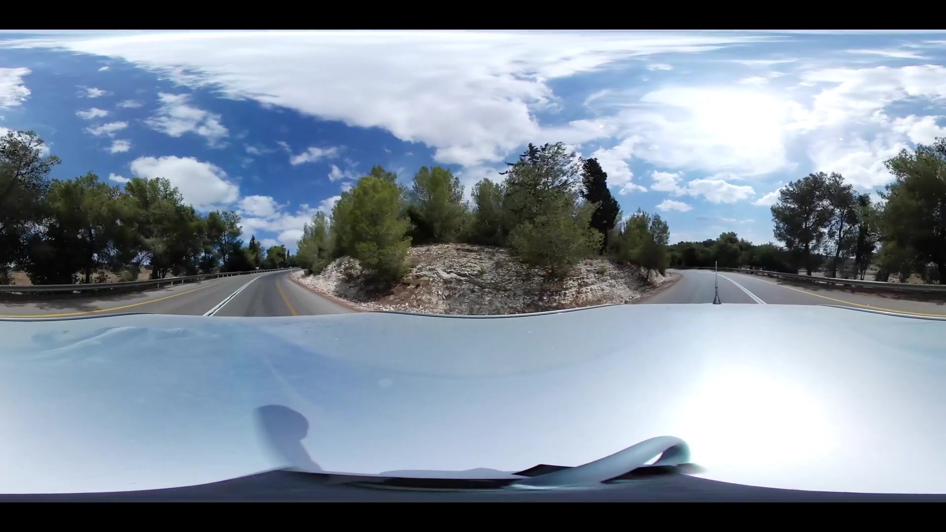 360 VR video of a car driving through a countryside road in nature