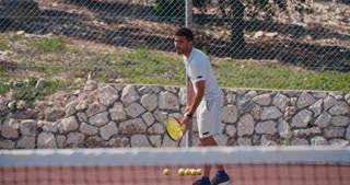 A tennis player hitting the ball during a tennis game