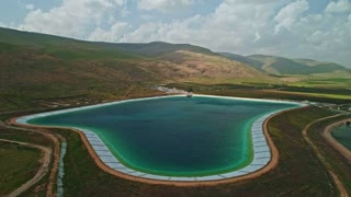 Aerial footage of a large water reservoir in north Israel