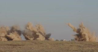 Bombs hitting targets during an airstrike