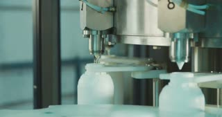 chemical bottles in a production line