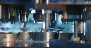 Close up shot of a punch press forming metal parts