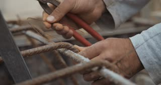 Clouse up slow motion shot of construction worker hands