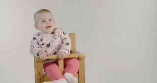 Cute baby smiling on a white studio background