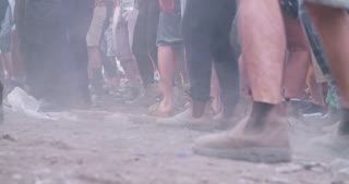 feet of people dancing in a nature trance party