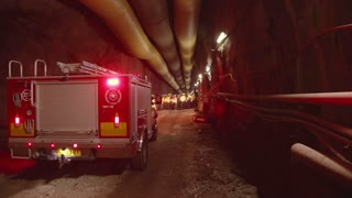 Firefighter truck inside a dark tunnel