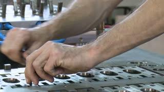 hands of engineer assembling metal parts