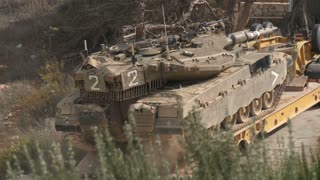 Israel, Circa 2011 - IDF tank driving next to the lebanon border
